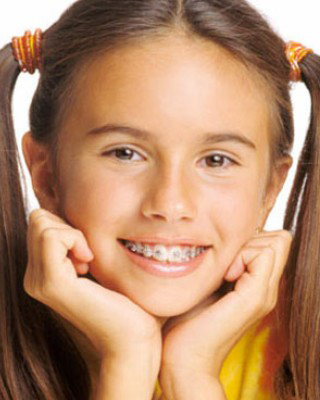 Young girl wearing metal braces