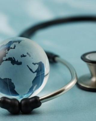 Globe surrounded by stethoscope